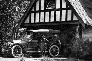 Rattenbury's chauffeur and 1913 Cadillac in front of Coach House