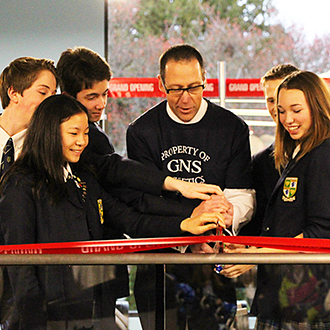 Cutting the ribbon of the new Scott Fitness Centre